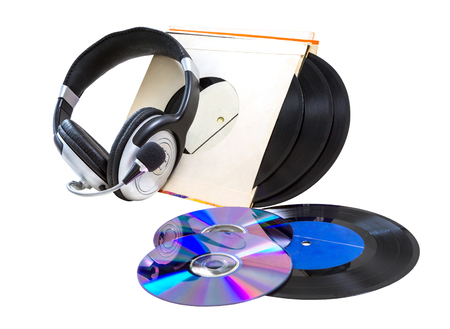headphones, vinyl records and cd CD-R, DVD on a white background. isolated
