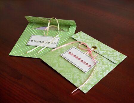 cd rw: festive handmade envelope for CD discs. scrapbooking. craft Stock Photo