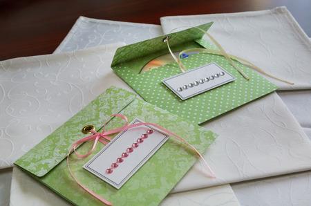 cd rw: Celebratory envelope handmade CDs on white napkins. scrapbooking. craft