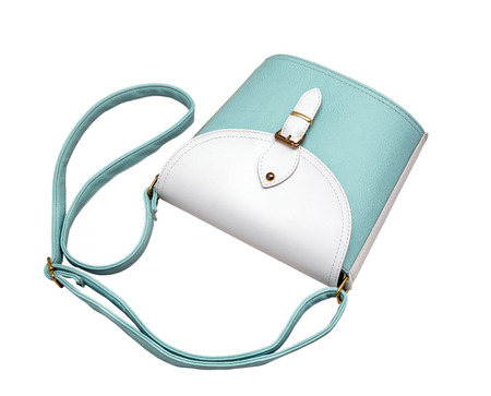 personal shopper: bags, turquoise, woman, glossy, leather, isolated, white, background.  top view Stock Photo