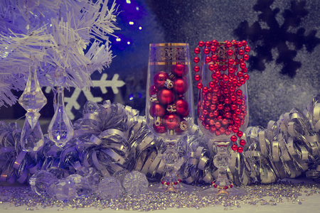 new year eve beads: Christmas still life with champagne and red background busamina window decoration with light garlands, vintage, retro, old style picture Stock Photo