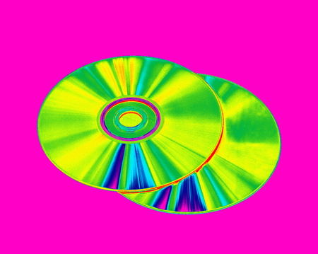 megabytes: CD-ROMs and DVD-discs on a pink background, a color gradient image