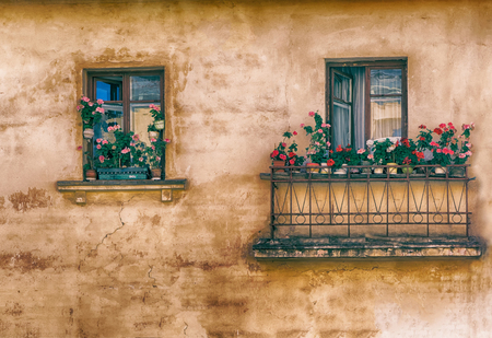 balcony window: window, balcony with flowers on the windowsill, retro, vintage, old-style photo image. Stock Photo