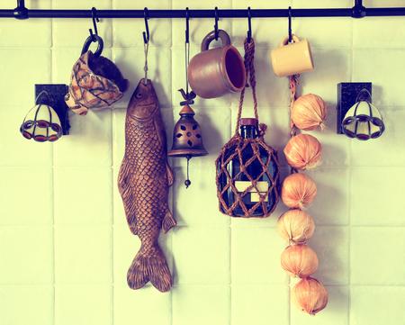 Retro kitchen fragments of the interior walls, railings, mugs, wall, onion