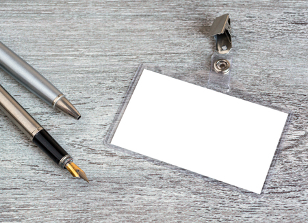 behind the scenes: pen, badge, blank ID card or security, macro, view from above Stock Photo
