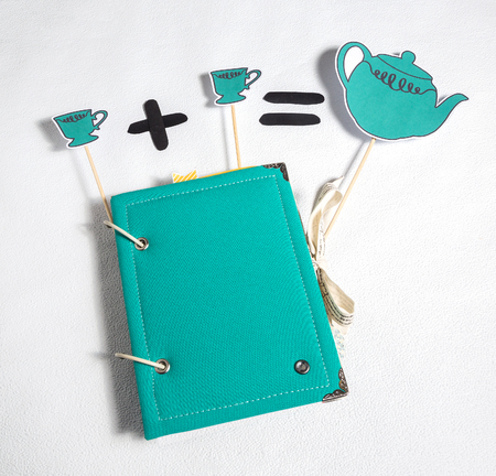 chucky: set scrapbooking album, festive accessories cup, teapot, white background