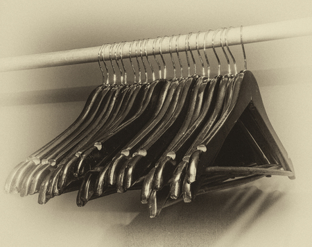 closet rod: old wooden clothes hangers, close-up, retro, vintage, black and white photo
