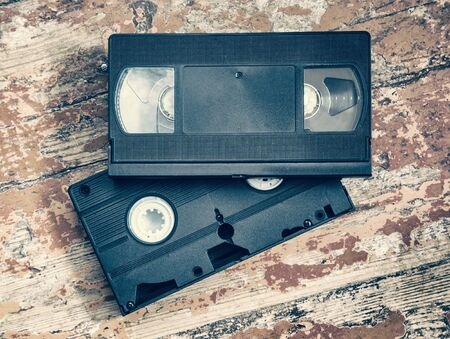 videocassette: Two video cassette close-up on a wooden surface, retro-style, old, record sound and images