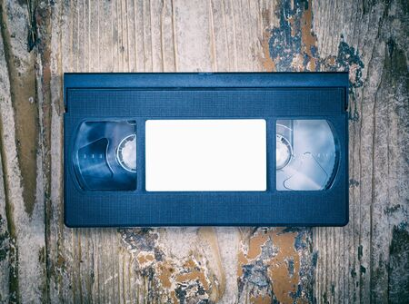 mass storage: video cassette close-up on a wooden surface, retro-style, old, record sound and images