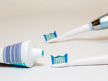 personal hygiene: Electric toothbrush on a white background, personal hygiene, the instrument