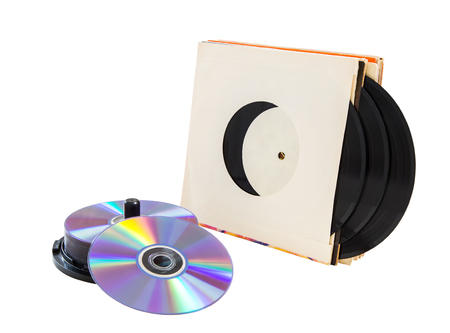 vinyl records and cd CD-R, DVD on a white background. isolated Stock Photo