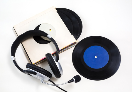 vinyl records: headphones, vinyl records on a white background. isolated