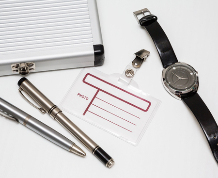 office tools blank notepad with pen, glasses and badge security