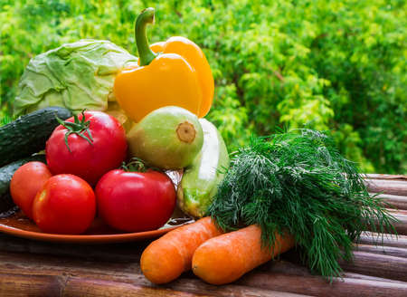 Healthy food from village. Eco food concept.  Fresh organic vegetables on wood table in the garden.