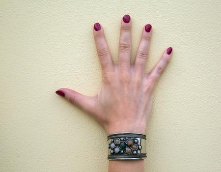 a bracelet: jewelry bracelet women on an old wooden surface, modern fashion, charms, jewelry, macro