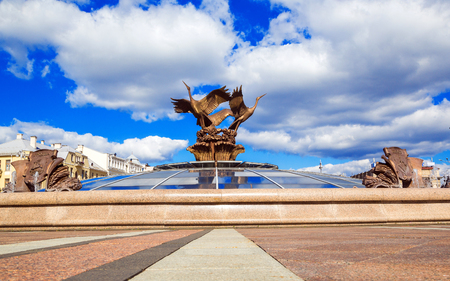 Minsk, Belarus: August 25, 2016: Three storks sculpture in the fountain in Independence Square