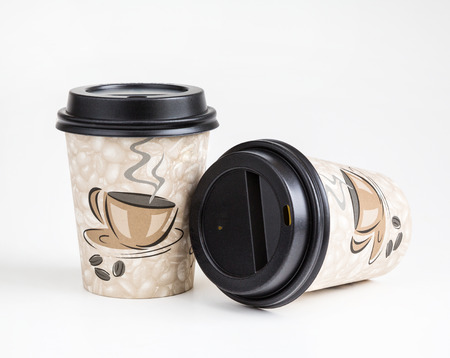 paper cup for drinks, disposable utensils, on a white background, recycled material degradable in nature, environmental protection