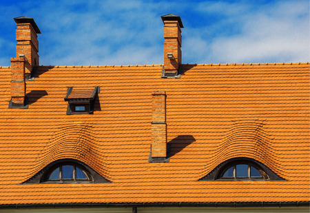 dormer: dormer windows of the old house with a tiled roof Stock Photo