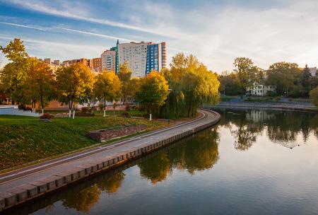 svisloch: Minsk, Belarus, river Svisloch embankment Street Belarusian against the backdrop of the sunset sky
