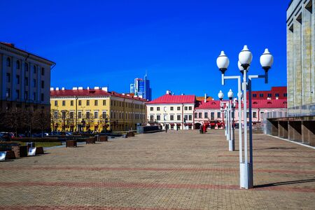 minsk: Minsk Belarus - March 23, 2017, Oktyabrskaya square view of the old city against the blue sky, architectural monument, editorial