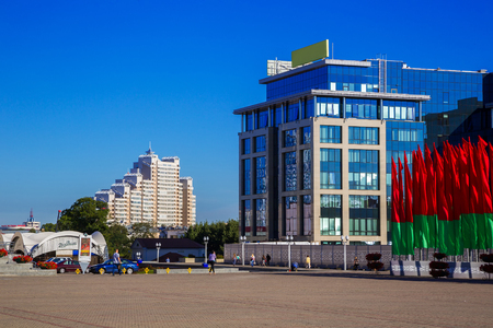 Minsk Belarus - March 23, 2017, Oktyabrskaya square view of modern architecture against the blue sky, editorial Editorial