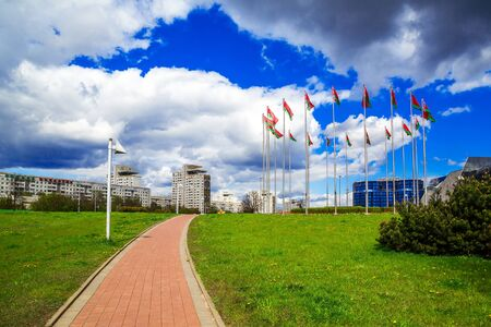 Belarus, Minsk, 11 May 2017; panoramic view of the buildings of the architectural complex East on Independence Avenue against the blue sky, river, embankment, editorial