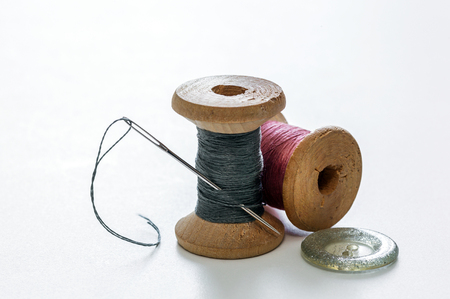 Creative image of sewing accessories for needlework and sewing, hobby, on white background, retro style