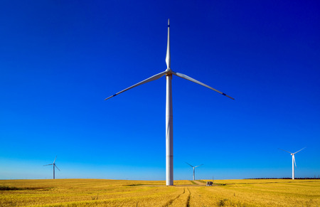 Windmills for the production of electrical energy, ecology, preserving nature Stock Photo