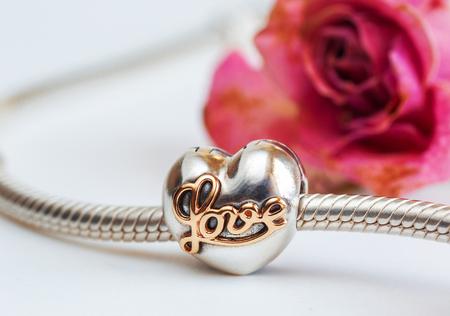 jewelry bracelet female on a white background, modern fashion, amulets, macro, retro style