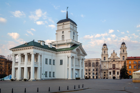 Minsk, Belarus, the Town Hall buildings and the Roman Catholic Church near Freedom Square. 15042018, editorial