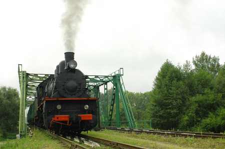 Old locomotive on the railway, steam locomotive outdoors,
