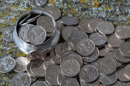 Russian money coins on an old wooden surface, pennies, metal, retro style, selective focus, top view Фото со стока