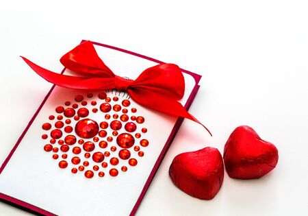 Postcard for Valentine's Day with red hearts and on March 8, the wedding day, the concept of love. Space. white background