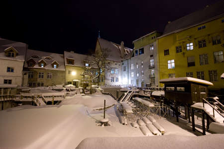 Snow covered medieval town at night photo