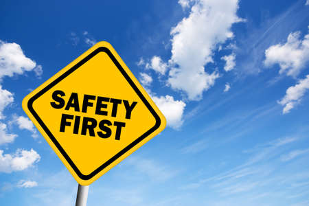 Safety first illustrated sign over blue sky photo