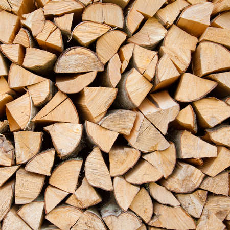 pile of logs: Stack of firewood Stock Photo