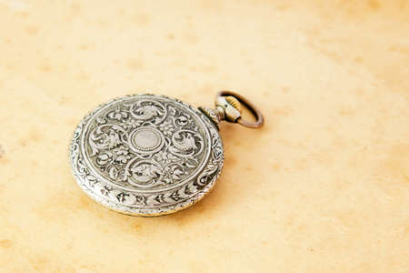 watch over: Ancient pocket watch over sepia background