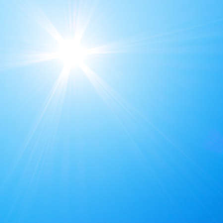 shining light: Sun shining in blue sky Stock Photo