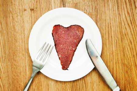i like: Heart shaped beef slice, i like meat concept Stock Photo