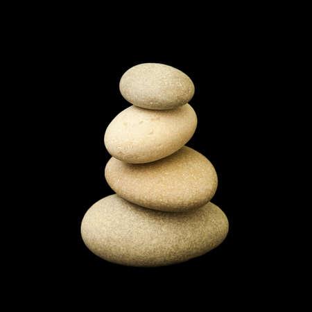 Balance stone pyramid isolated on black background Stock Photo