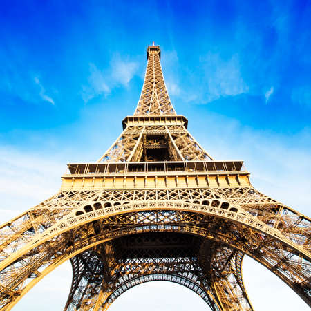 europe: Eiffel tower over blue sky Editorial