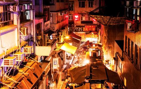 old photo: HONG KONG - 20 APRIL 2017: Night food street in Chinatown, Hong Kong
