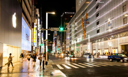 TOKYO, JAPAN – March 30, 2017: Ginza at night - shopping district in central Tokyo with many famous brand stores