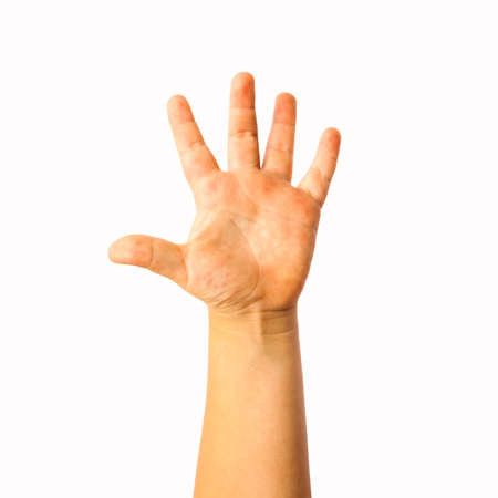 Child raised hand photo isolated on whie background Foto de archivo