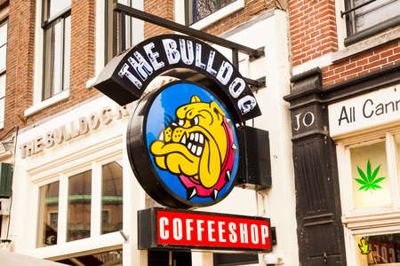 AMSTERDAM, NETHERLANDS - 19 April 2018: The Bulldog advertising sign – popular chain of cannabis coffee shops in Holland