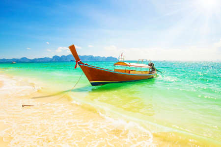 Long boat and blue sky in Krabi provinces, Thailand, travel photo Stock Photo