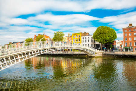 DUBLIN, IRELAND - June 17, 2018: Hapenny Bridge and Liffey river