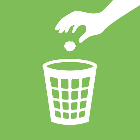 Hand throwing paper in a basket