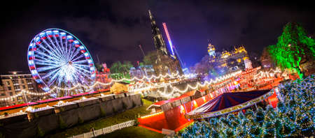 Wide panoramic view of Edinburgh's Christmas market, rotated photo for more dynamic effect