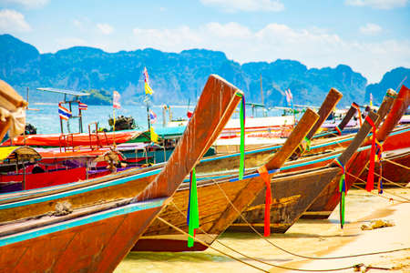 Longtail boats on tropical beach in Thailand, Krabi province
